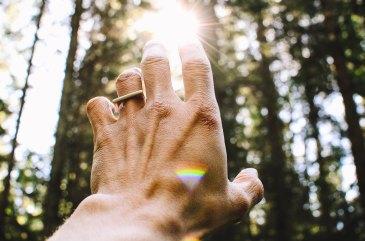Hand reaching toward the sun